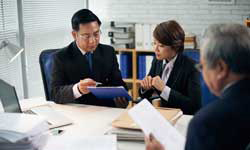 Attorneys Asian awyer and intern working together