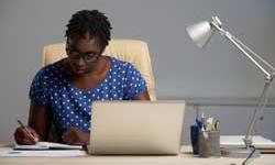 Financial Planner black businesswoman checking planner