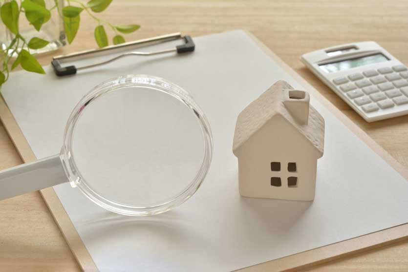 Tax Assessment Appeals Magnifying glass and house